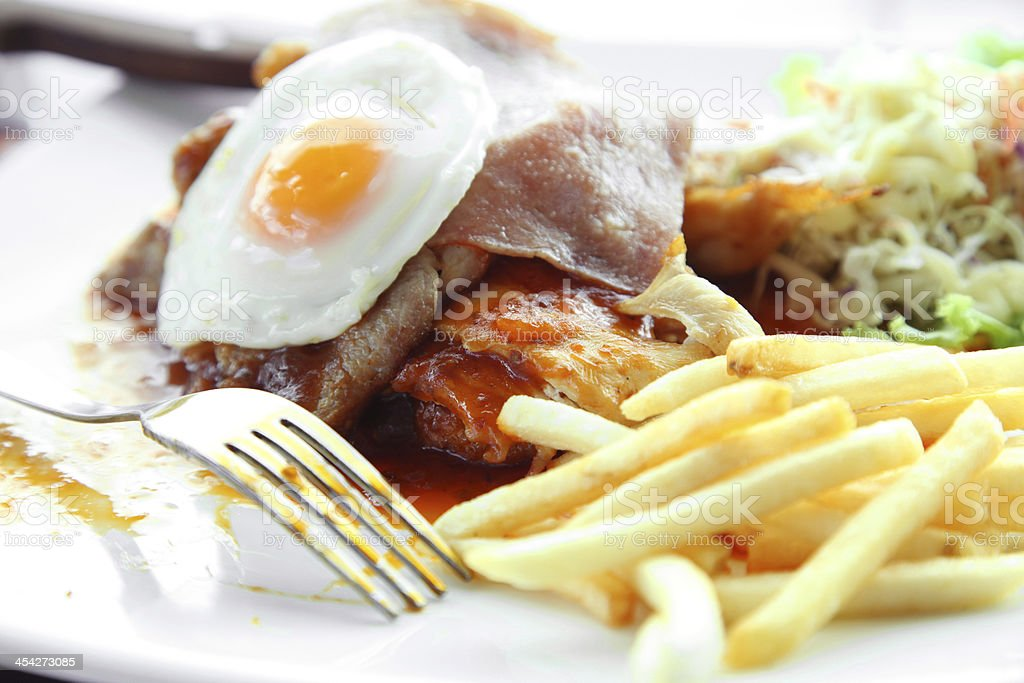 Juicy steak meat with french fries and fried eggs. royalty-free stock photo
