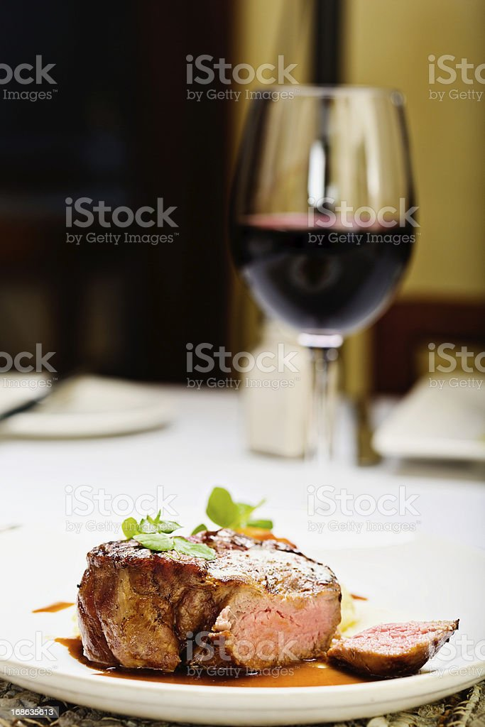 Juicy steak with glass of red wine; the perfect meal stock photo