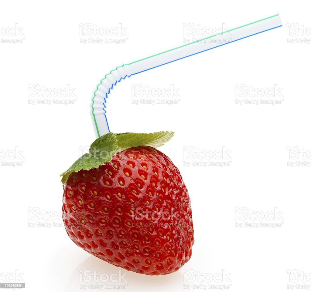 Juicy strawberry with cocktail straw royalty-free stock photo