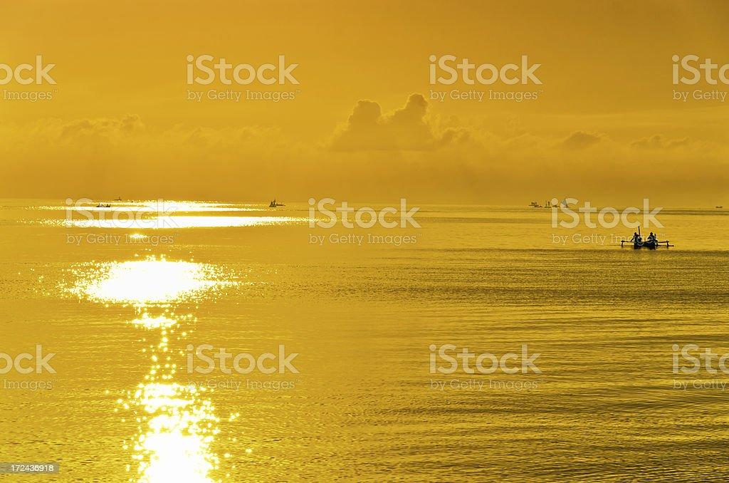 Jukung of fisherman in Bali at sunrise royalty-free stock photo