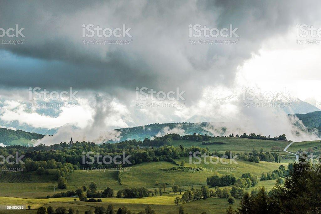 Julian Alps from Banjsice, church tower in Primorska, Slovenia, Europe stock photo