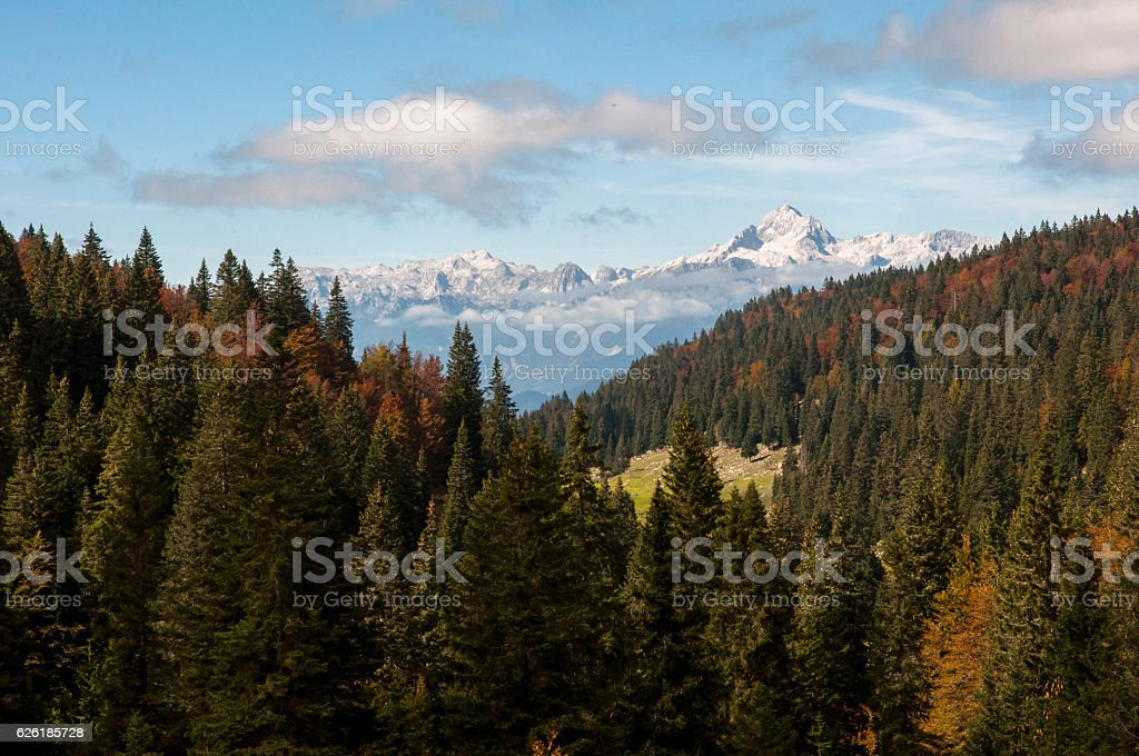 Julian Alps, Triglav and autumn forest stock photo