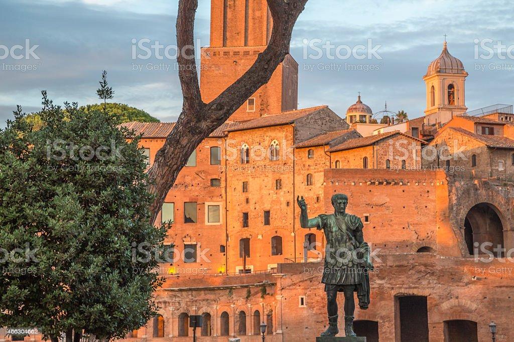 Julius Caesar bronze statue in Rome, golden hour stock photo