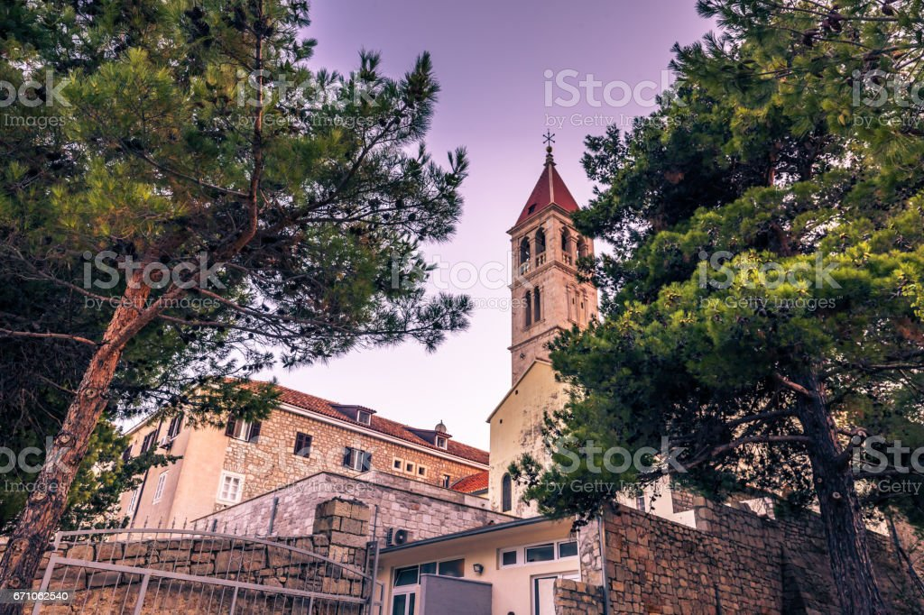 July 18, 2016: Tower of the church of the town of Bol, Croatia stock photo