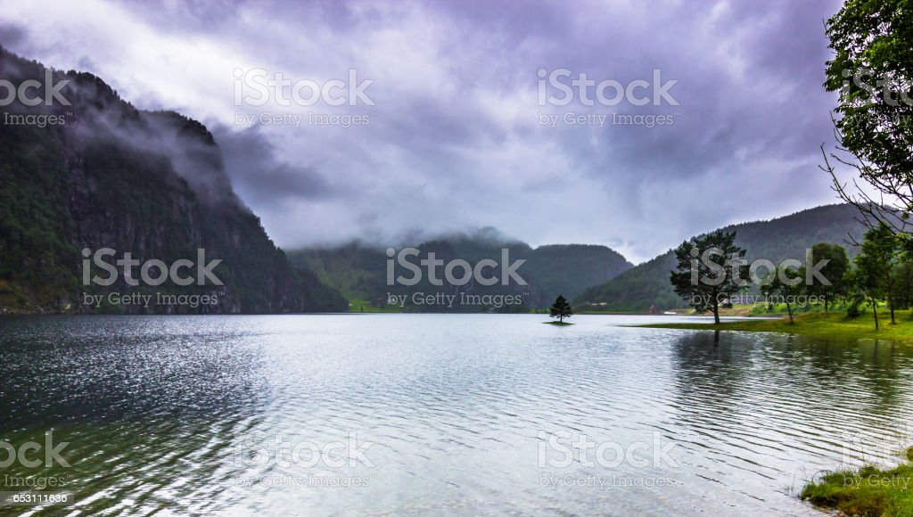 July 21, 2015: A tranquil lake in the countryside of Norway stock photo