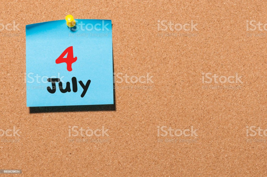 July 4th. Day 4 of month, color sticker calendar on notice board. Summer time. Empty space for text stock photo