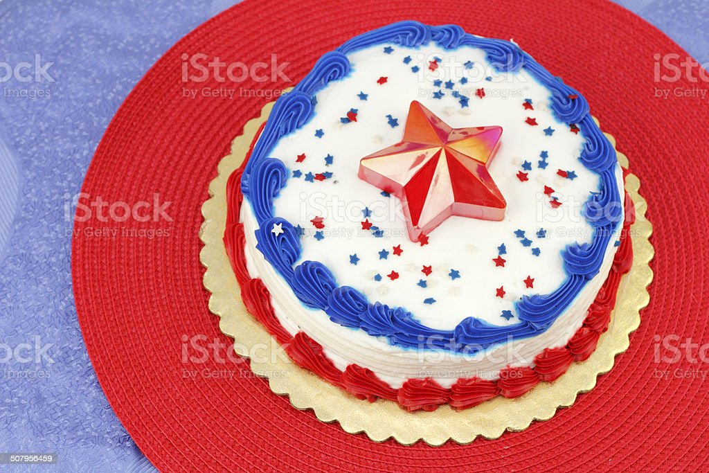 Round Independence Day holiday cake decorated with white frosting,...