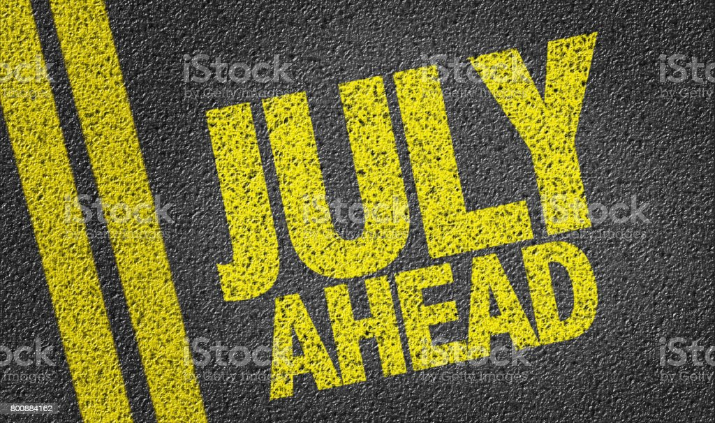 July Ahead written on the road stock photo