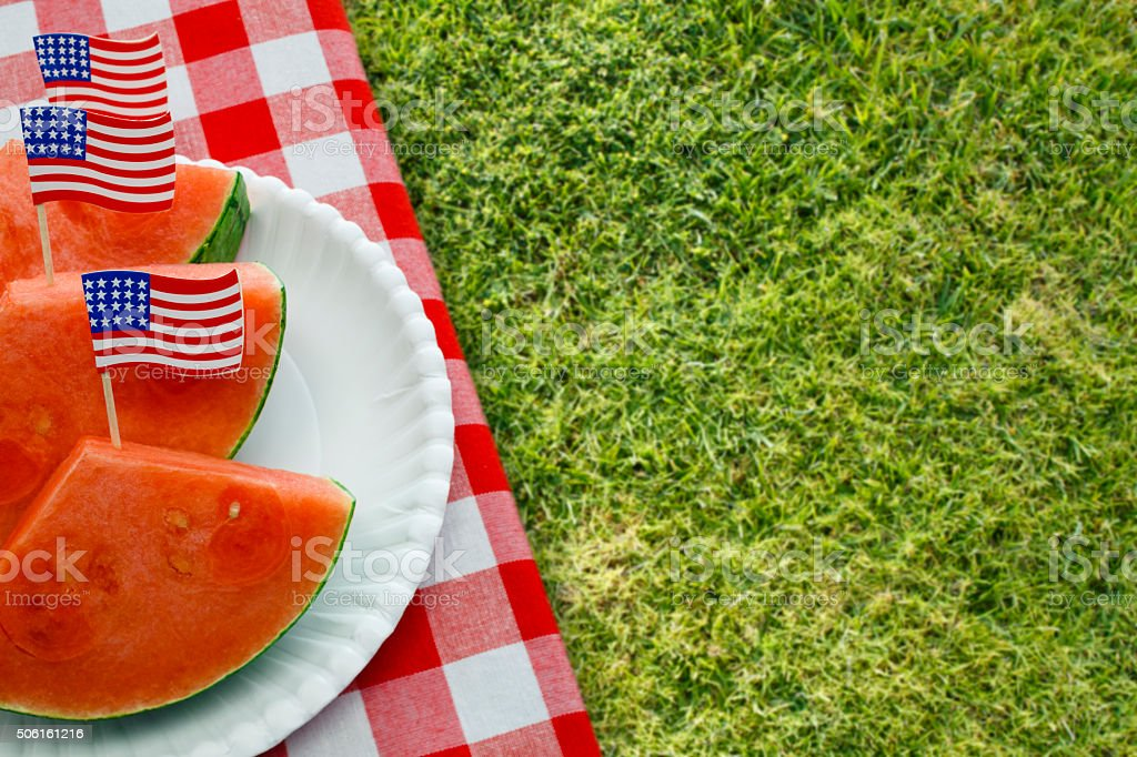 July Fourth Patriotic Picnic with Watermelon on Lawn stock photo