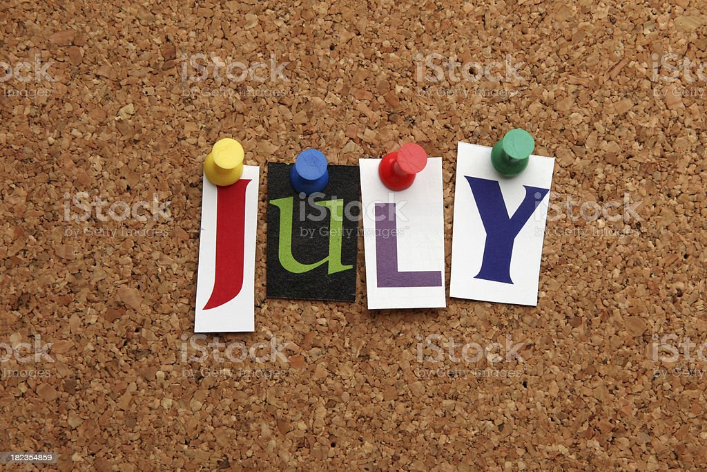 July pinned on noticeboard stock photo