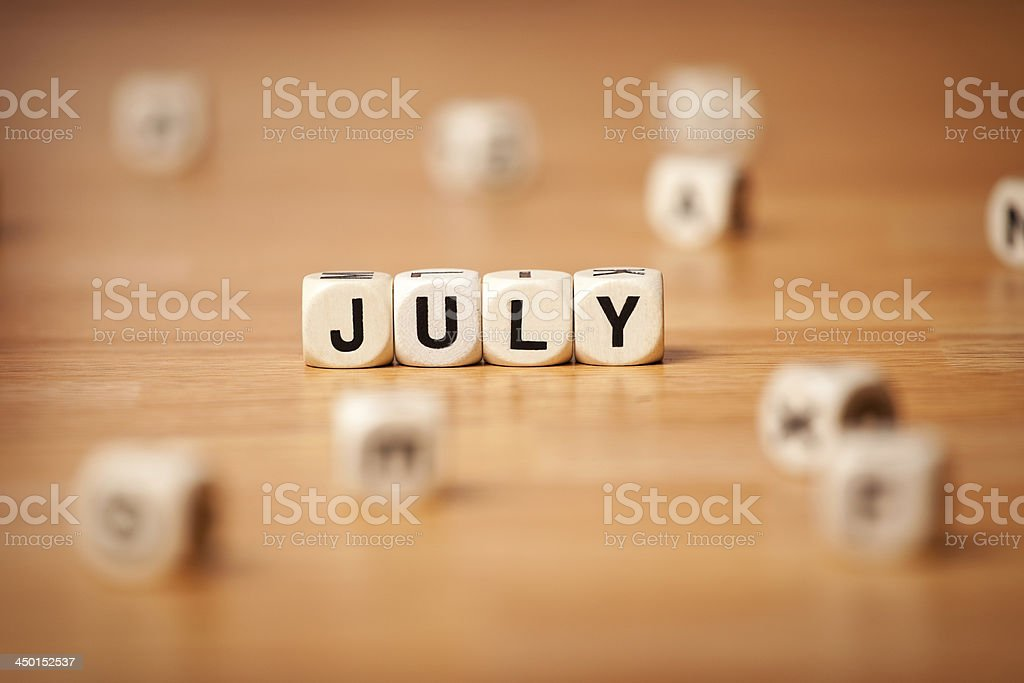 July Spelled In Letter Cubes royalty-free stock photo