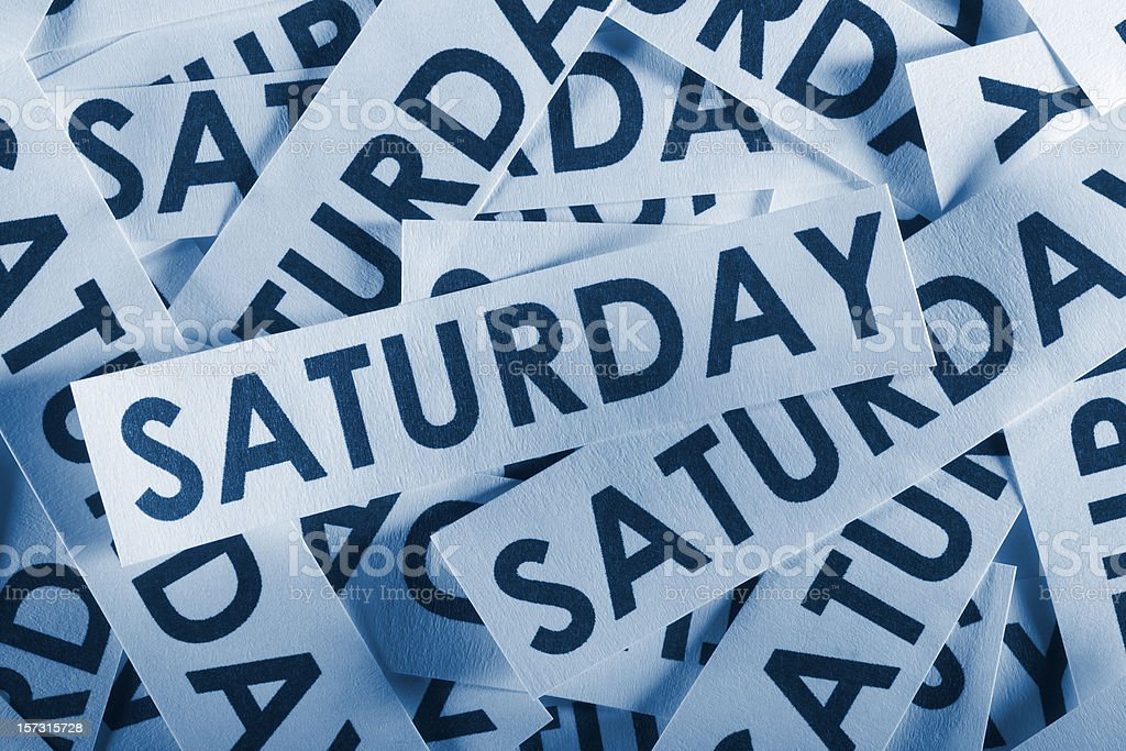 Jumble of paper cutout pieces containing the word SATURDAY royalty-free stock photo