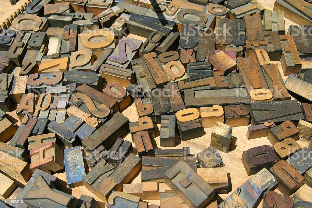 Jumbled wood block print letters stock photo