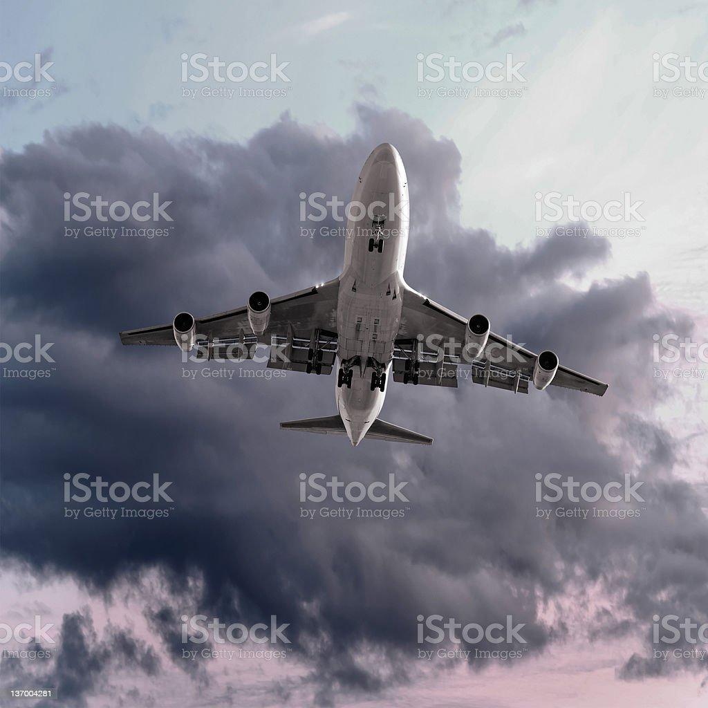 XXL jumbo jet airplane landing at dusk royalty-free stock photo