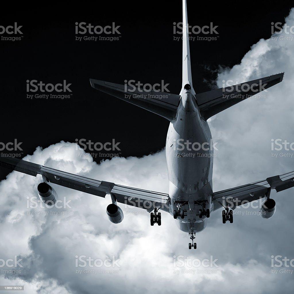jumbo jet airplane landing at night royalty-free stock photo