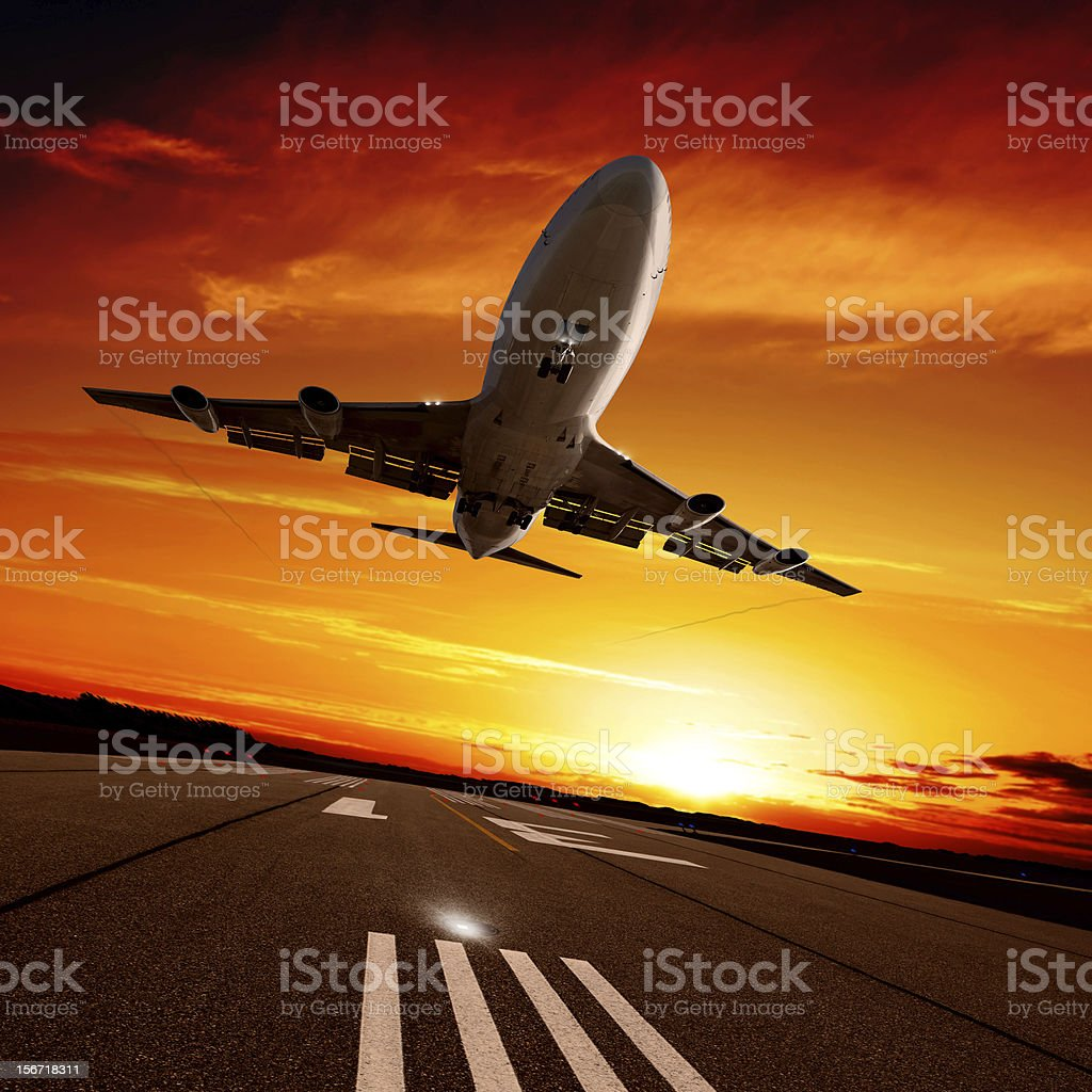 XXL jumbo jet airplane landing at sunset royalty-free stock photo