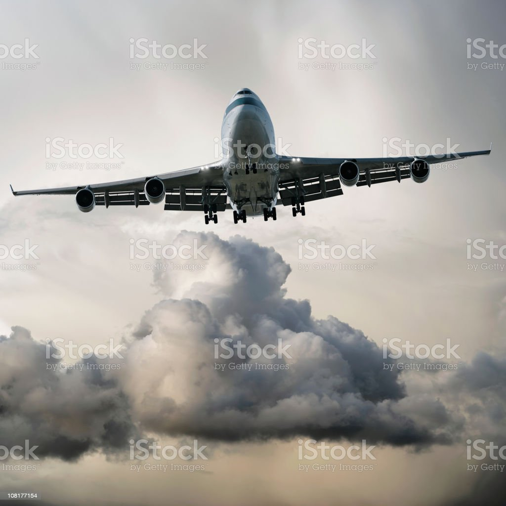 jumbo jet airplane landing in storm stock photo