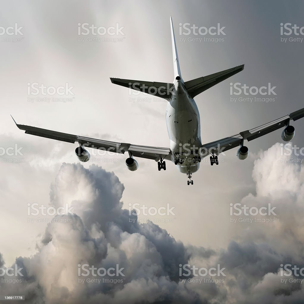 XL jumbo jet airplane landing in storm stock photo