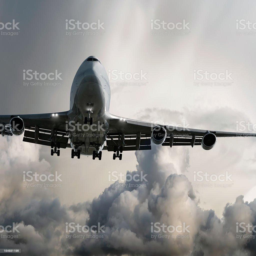jumbo jet airplane landing in storm stock photo