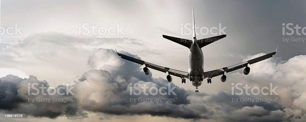 XXL jumbo jet airplane landing stock photo