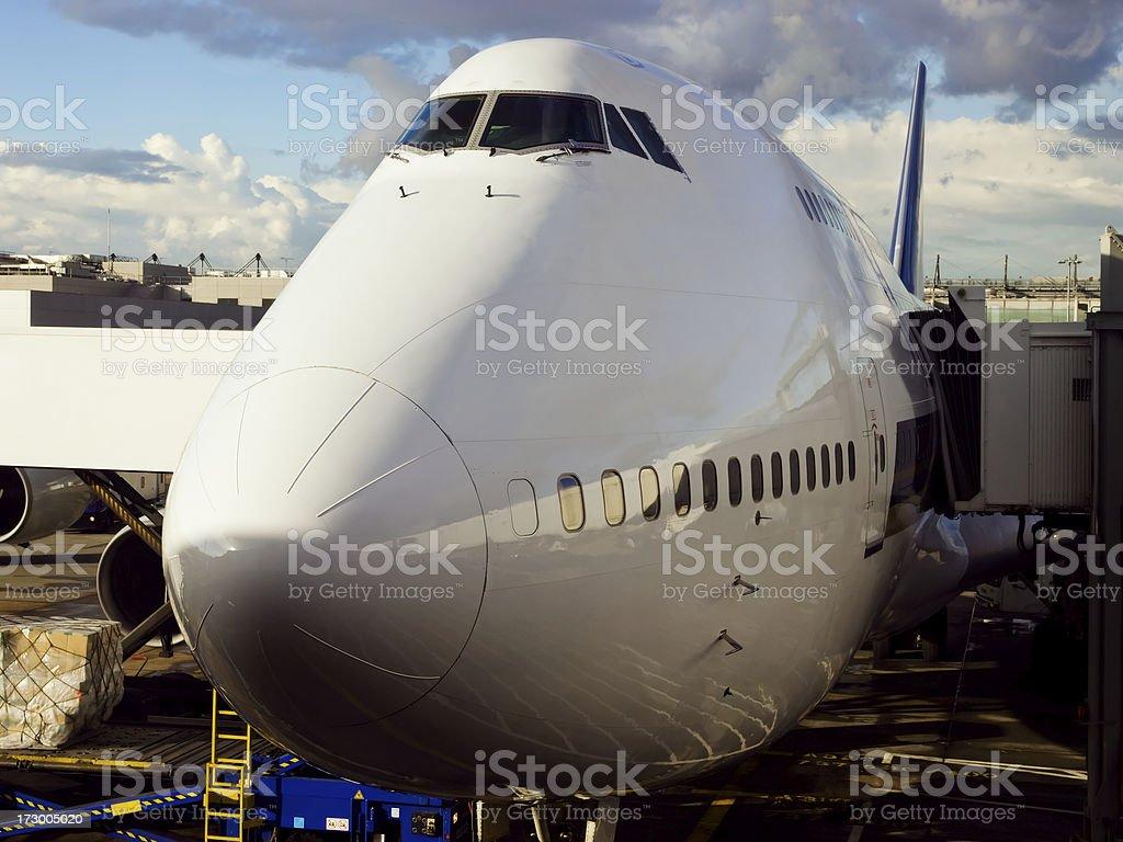 Jumbo Jet At Aerobridge stock photo