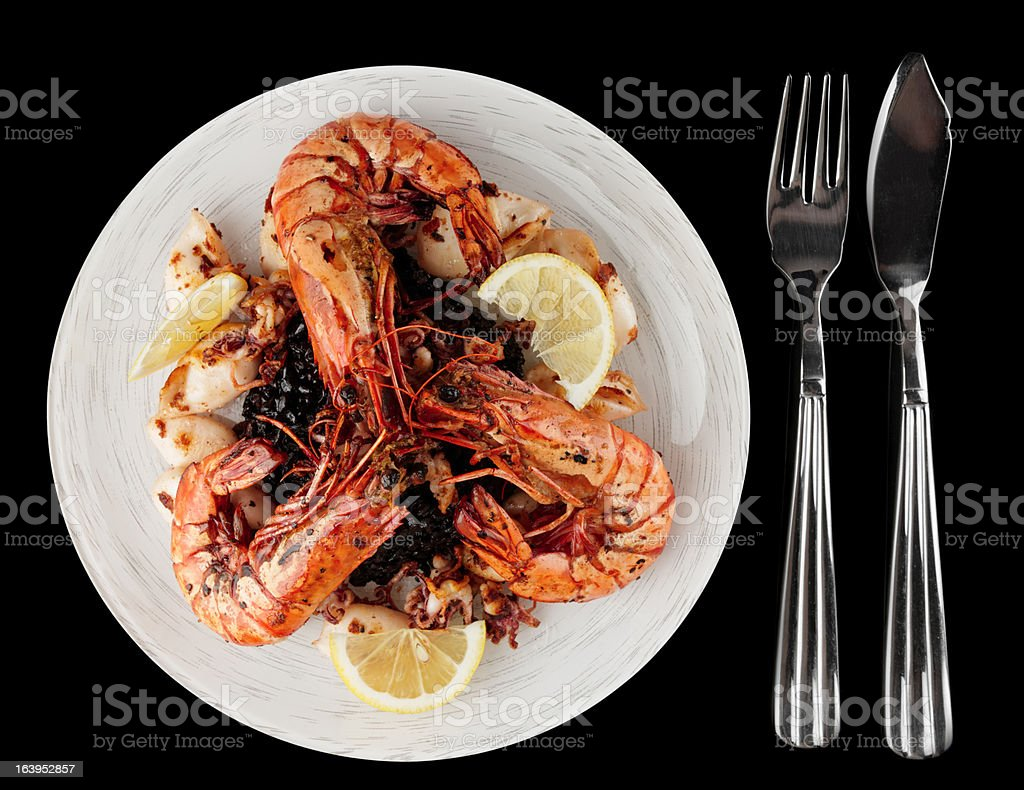 Jumbo prawns and grilled squids with black rice royalty-free stock photo
