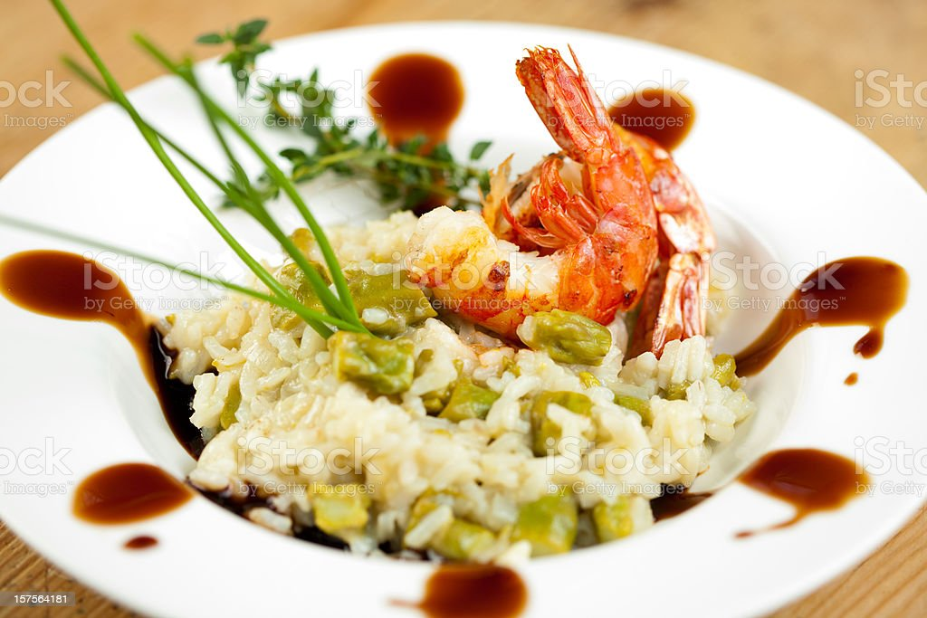 Jumbo shrimp and asparagus risotto royalty-free stock photo