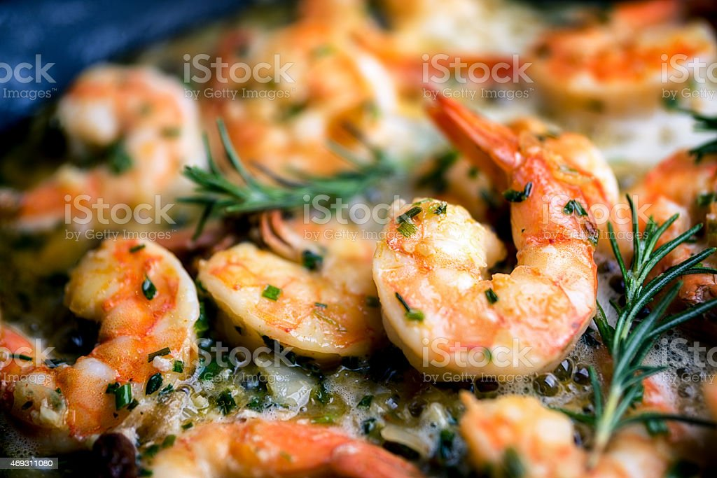 Jumbo Shrimp Scampi Sauteeing in Butter and Olive Oil stock photo