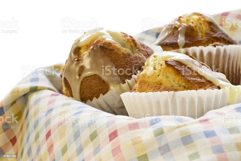jumbo sized lemon poppy seed muffins on a checked tablecloth stock photo