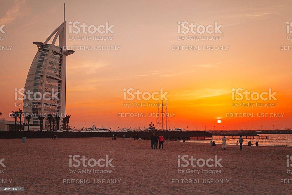 Jumeirah Beach and Burj Al Arab hotel at sunset stock photo