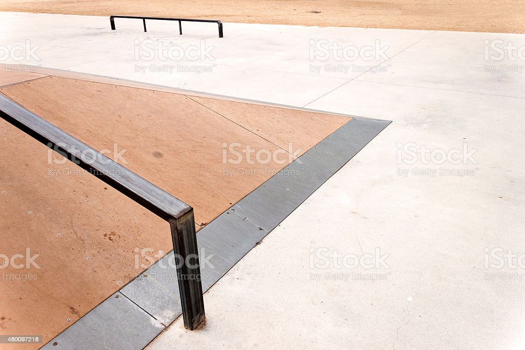Jump box with rail in an empty skate park. stock photo