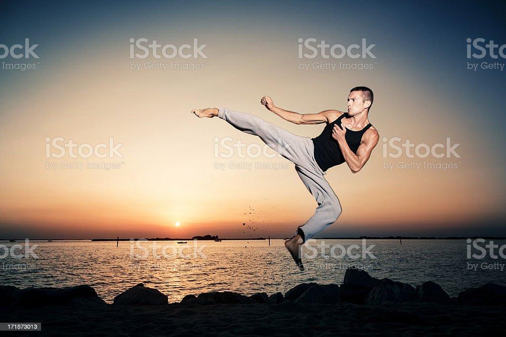 Jump fight man stock photo