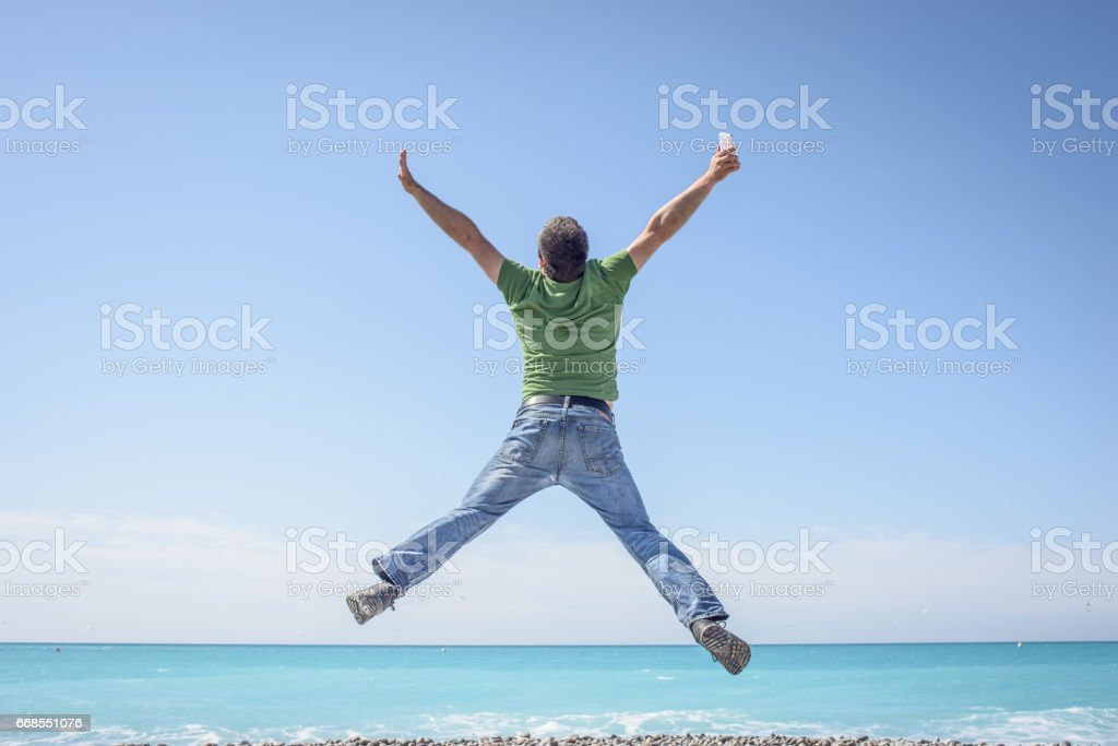 Jump for Joy Great Phone and Network on Vacation stock photo