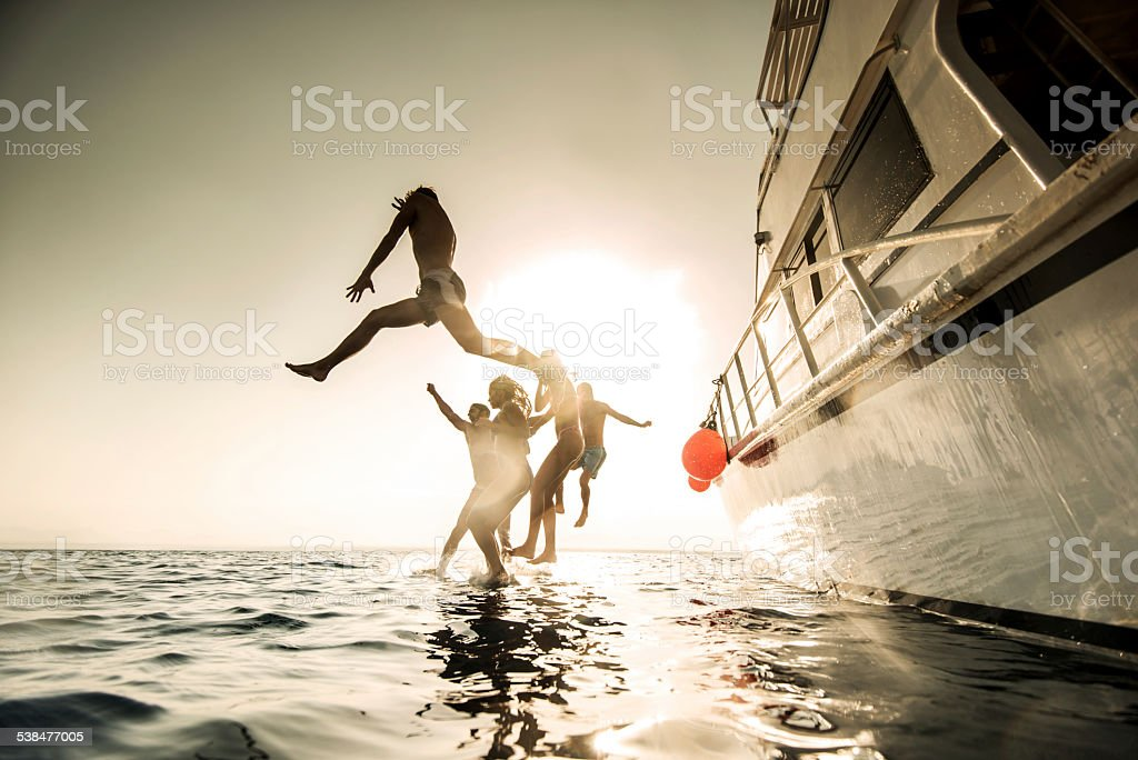 Jump from boat! stock photo
