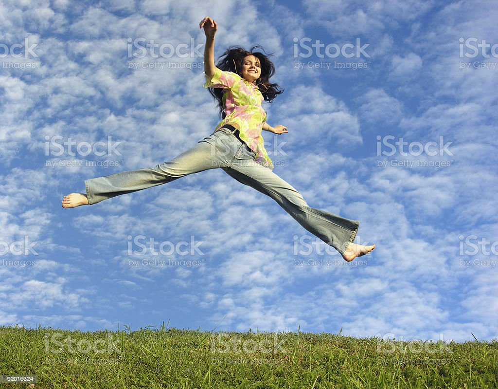 jump girl under cloud sky stock photo