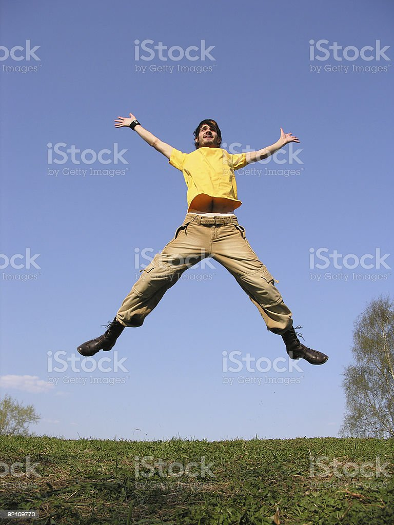 jump guy on meadow stock photo