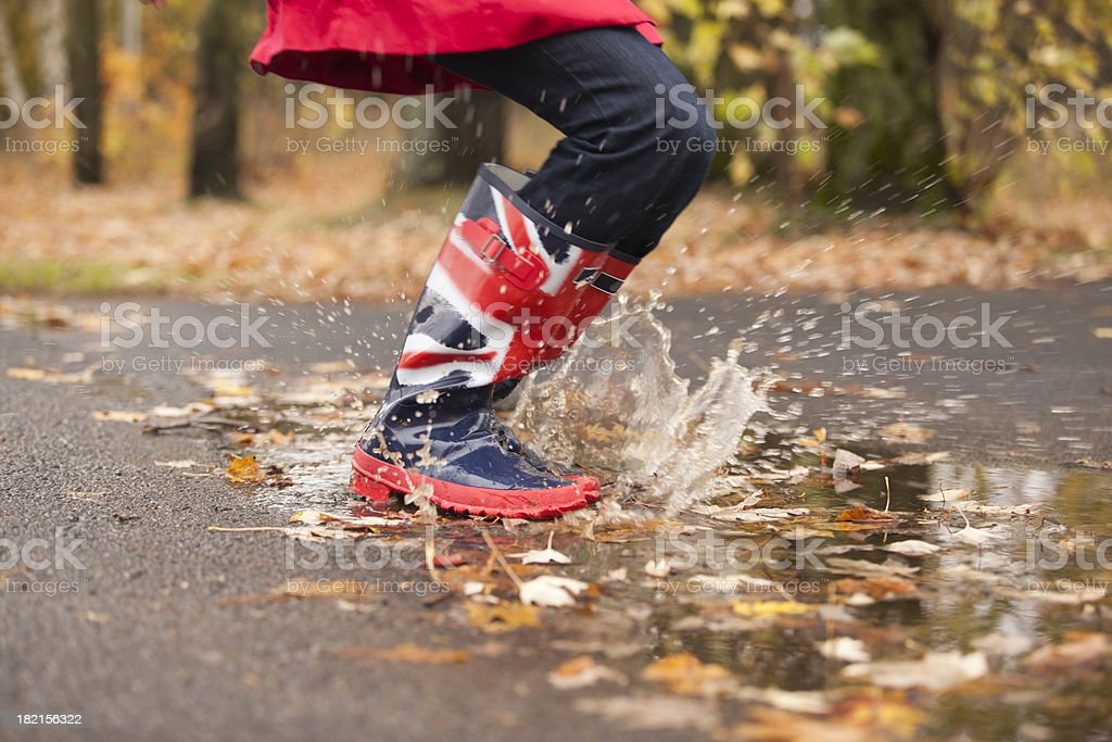 Jump into a water Puddle royalty-free stock photo