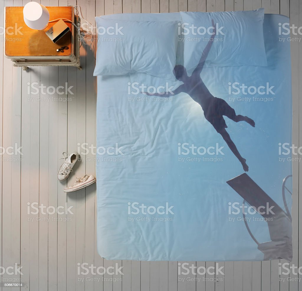 Jump into the bed stock photo
