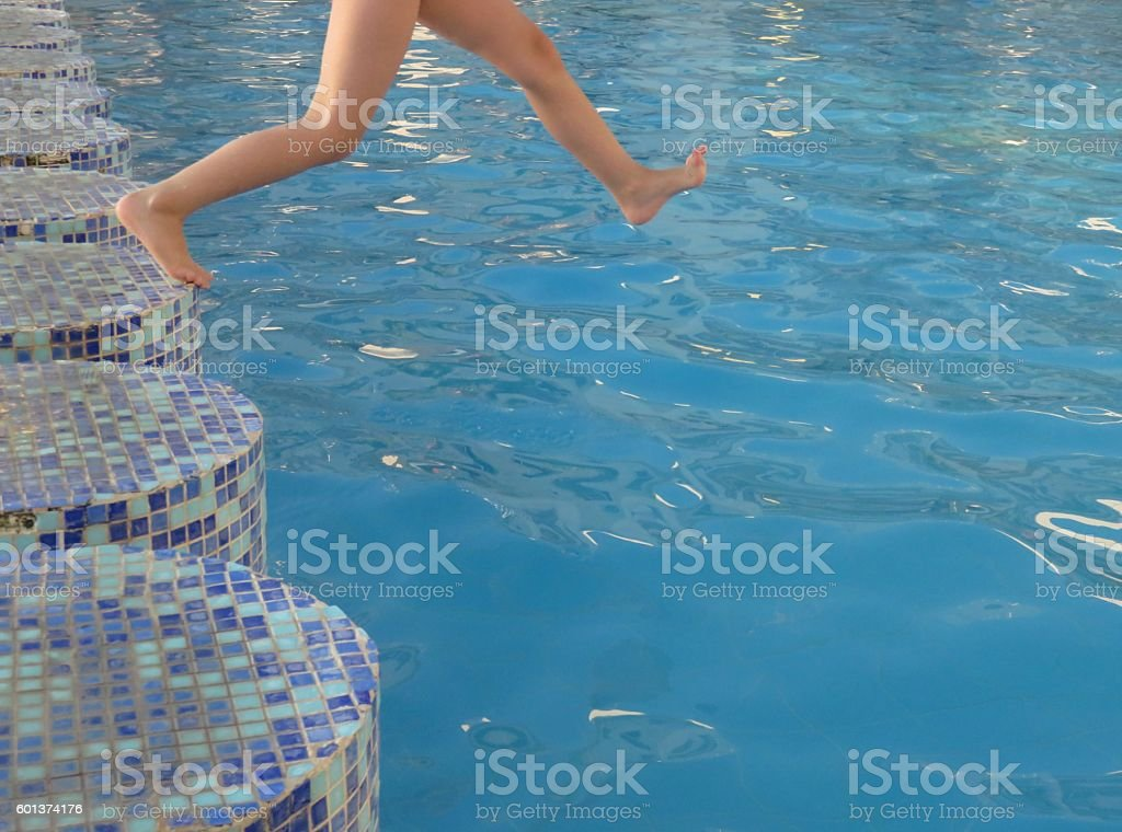 Jump into the water stock photo