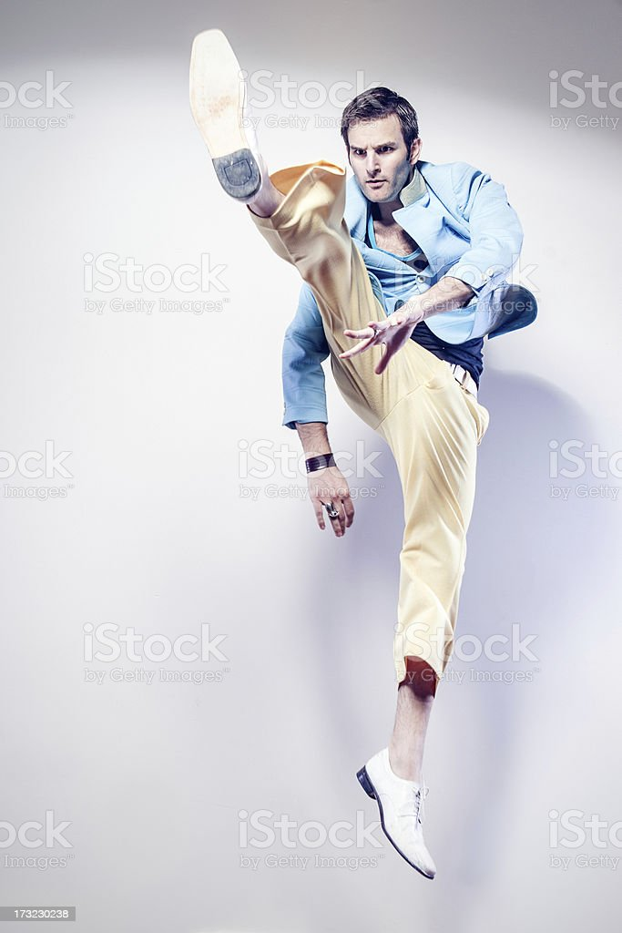 Jump Kicking Man stock photo