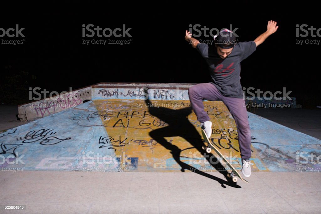 Jump of a skater in the night stock photo