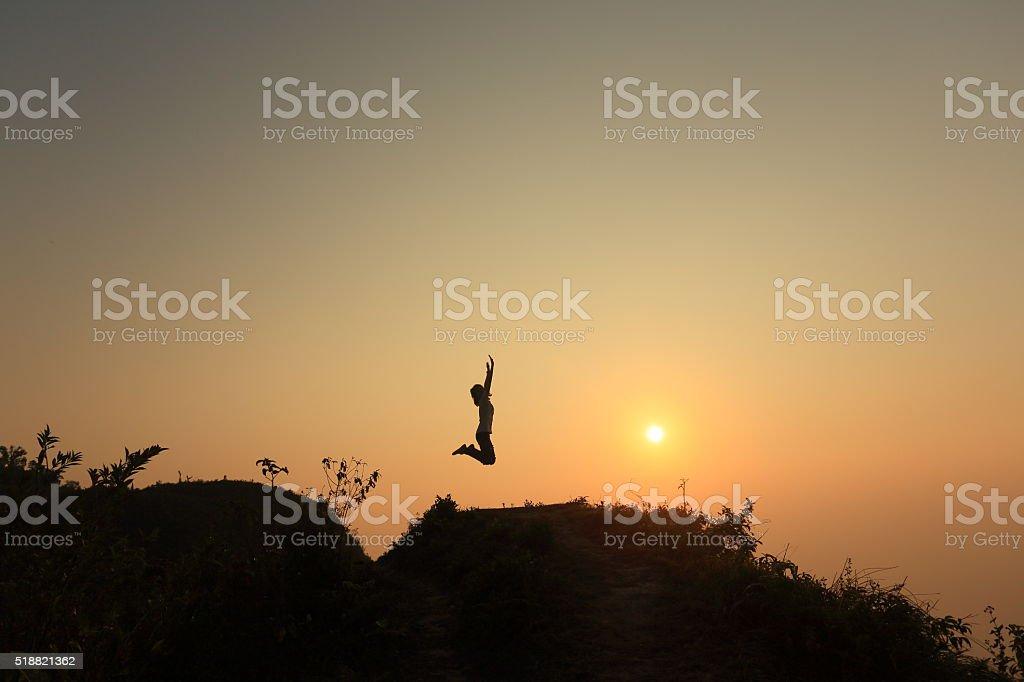 Jump on heart mountain stock photo