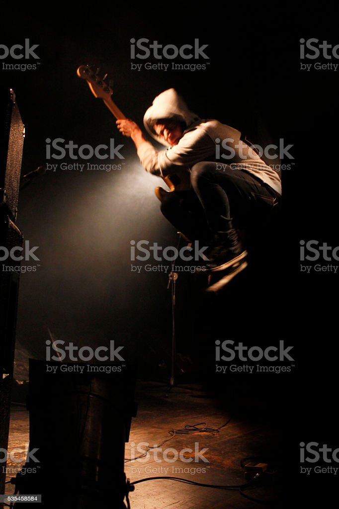 Jump on stage stock photo