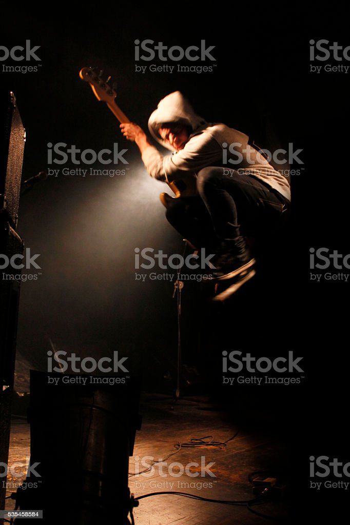 Jump on stage stock photo