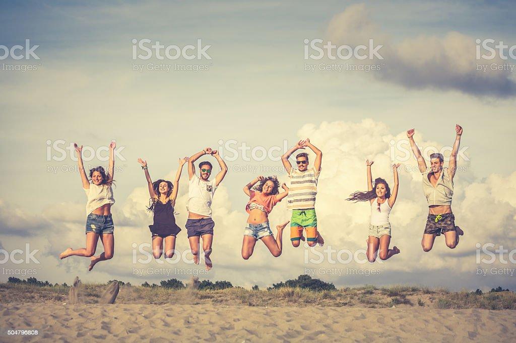 Jump on the beach stock photo