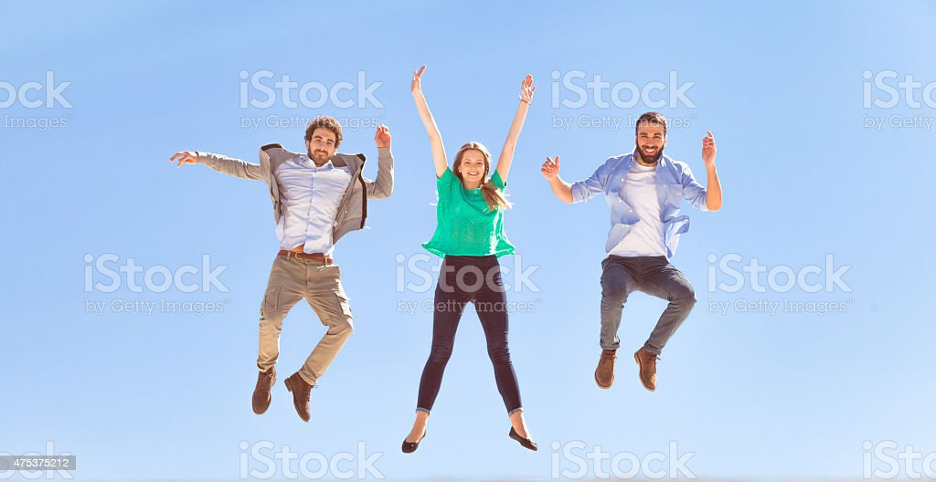 Jump on top of the world stock photo