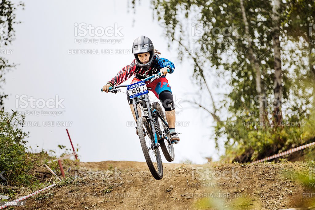 jump over mountain girls extreme athlete bike royalty-free 스톡 사진