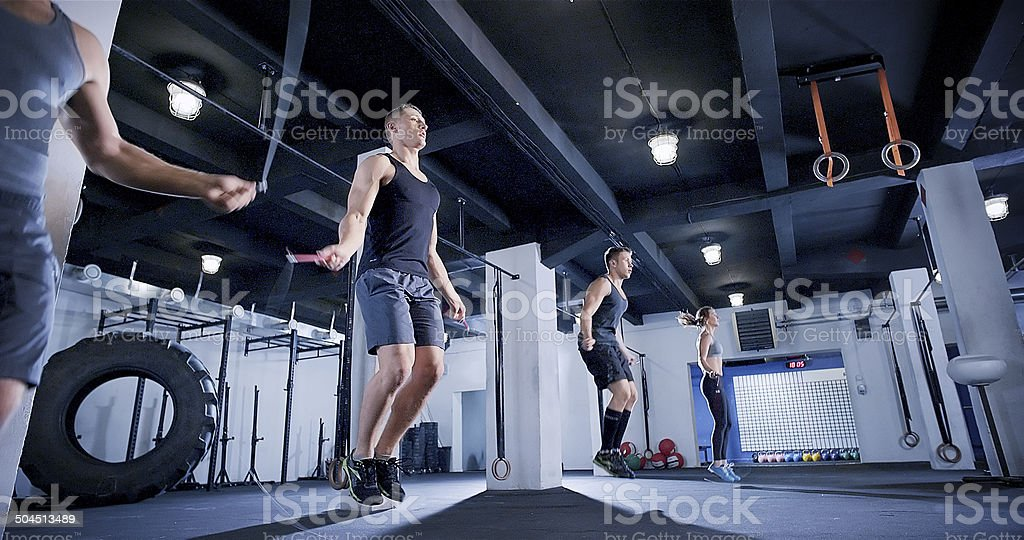 Jump rope warm up in crossfit club stock photo