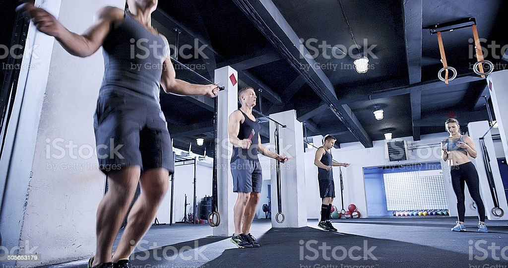 Jump rope warm up in gym club stock photo