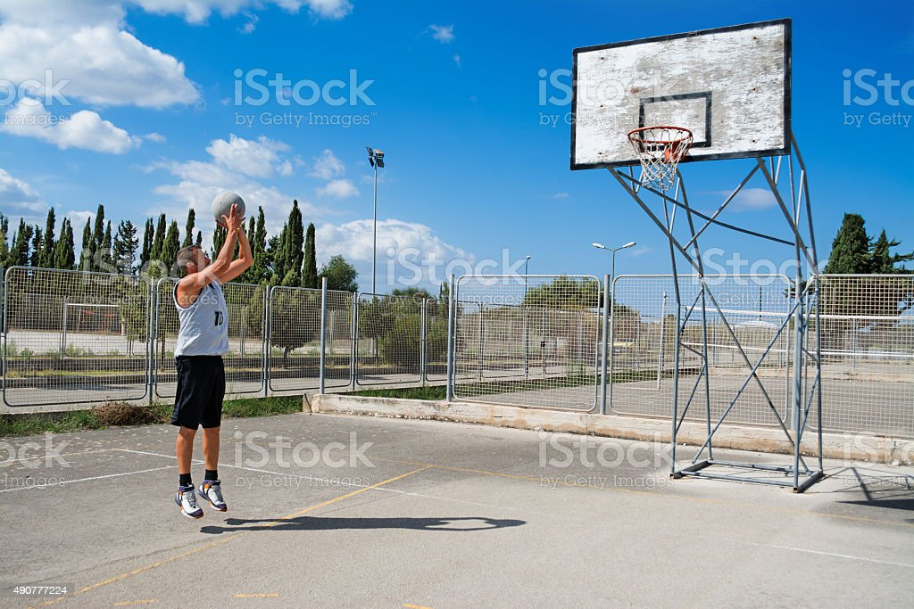 jump shot practice on a cloudy day stock photo